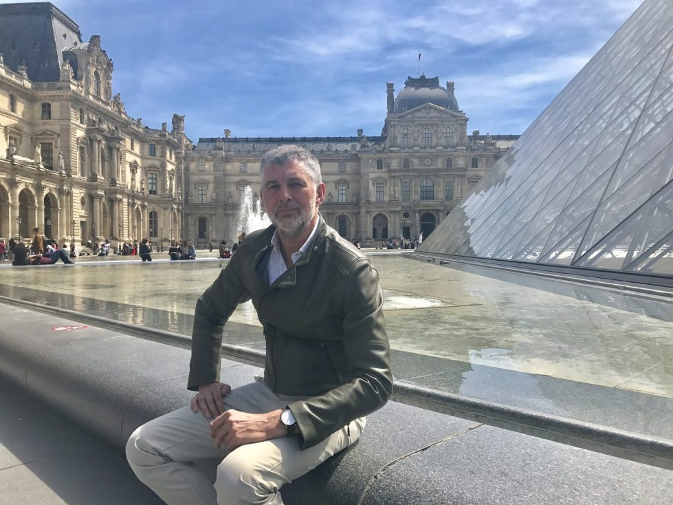 Eric Gizard, the NOWA watch designer, talking about his work in from of the Louvre Pyramid in Paris